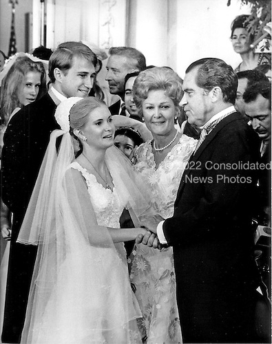 Washington, DC - June 12, 1971 -- Tricia Nixon Cox, left center and Edward Cox, left, say farewell to United States President Richard M. Nixon, right, and first lady Pat Nixon, center right, as they prepare to leave the White House after their wedding in the Rose Garden of the White House in Washington, D.C. on Saturday, June 12, 1971.  The glittering White House affair was attended by more than 400 friends and guests..Credit: Bill Allen / CNP