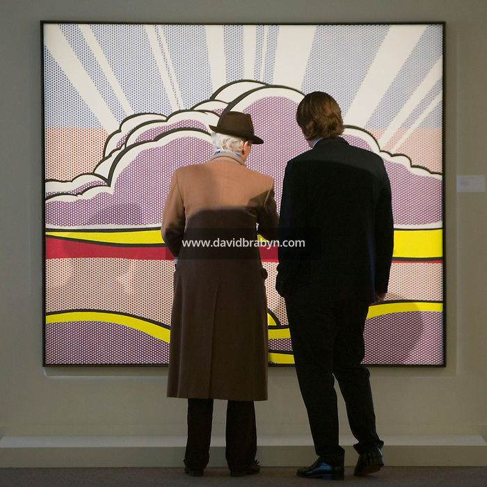 28 April 2006 - New York City, NY - People examine Roy Lichtenstein's painting, Sinking Sun, on display at the Sotheby's auction house in New York City, USA, ahead of a major sale of comptemporary art, 28 April 2006.
