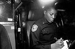 Memphis Police Officer Joyce Johnson fills out a report on a suspect apprehended for possession of drug paraphernalia. The suspect puts forth futile efforts to talk her way out of imprisonment.