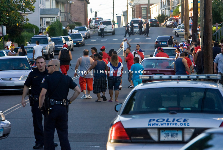 WATERBURY, CT - 06 JUNE 2010 -060610JT09-<br /> Waterbury Police disperse a crowd of people who were waving Puerto Rican flags at vehicles at the intersection of Baldwin and Madison Streets in Waterbury on Sunday.<br /> Josalee Thrift Republican-American