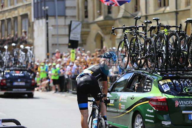 Bernhard Eisel (AUT) Team Sky passes by King's College as he waits for team mate Richie Porte (AUS) in Cambridge before the start of Stage 3 of the 2014 Tour de France running 155km from Cambridge to London. 7th July 2014.<br /> Picture: Eoin Clarke www.newsfile.ie
