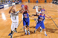 12 November 2010:  FIU's Stephon Weaver (2) and Florida Memorial's Bryan Portillo (44) battle for a rebound in the first half as the FIU Golden Panthers defeated the Florida Memorial Lions, 89-73, at the U.S. Century Bank Arena in Miami, Florida.