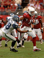 Nov. 6, 2005; Tempe, AZ, USA; Wide receiver (11) Larry Fitzgerald of the Arizona Cardinals evades safety (28) Michael Boulware of the Seattle Seahawks at Sun Devil Stadium. Mandatory Credit: Mark J. Rebilas