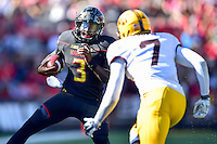 College Park, MD - OCT 15, 2016: Maryland Terrapins quarterback Tyrrell Pigrome (3) is pursued by Minnesota Golden Gophers defensive back Damarius Travis (7) during game between Maryland and Minnesota at Capital One Field at Maryland Stadium in College Park, MD. (Photo by Phil Peters/Media Images International)