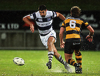Auckland's Paul Williams kicks ahead. Air New Zealand Cup rugby match - Taranaki v Auckland at Yarrows Stadium, New Plymouth, New Zealand. Friday 9 October 2009. Photo: Dave Lintott / lintottphoto.co.nz