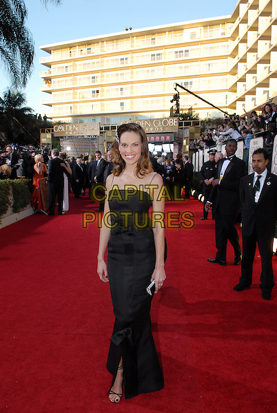 "HILARY SWANK.Red Carpet Arrivals - 64th Annual Golden Globe Awards, Beverly Hills HIlton, Beverly Hills, California, USA..January 15th 2007.globes full length black dress.CAP/AW.Please use accompanying story.Supplied by Capital Pictures.© HFPA"" and ""64th Golden Globe Awards"""