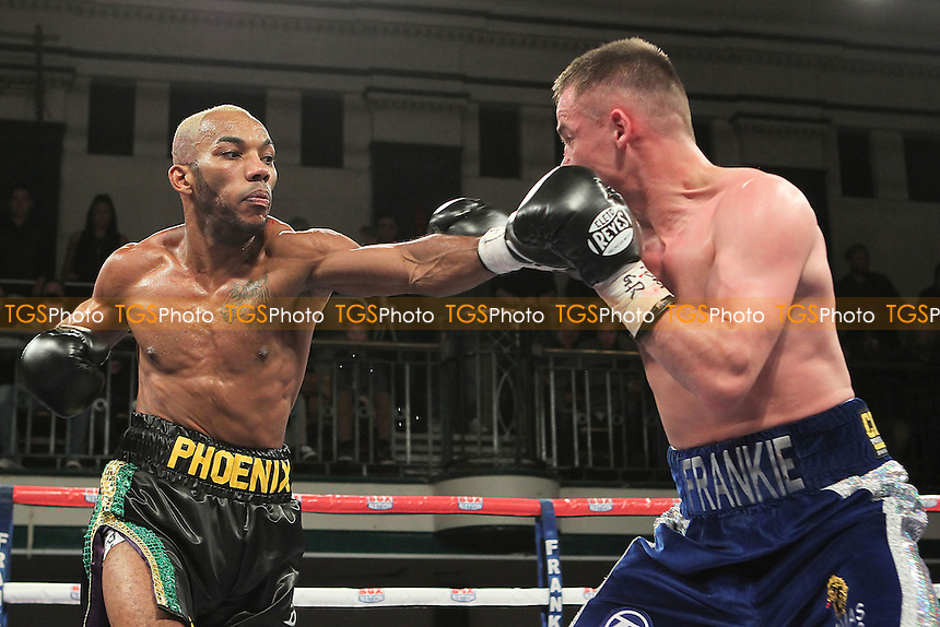 Frankie Gavin (blue shorts) defeats Junior Witter in a Welterweight boxing contest for the British Title at York Hall, Bethnal Green, London, promoted by Frank Warren - 01/11/12 - MANDATORY CREDIT: Gavin Ellis/TGSPHOTO - Self billing applies where appropriate - 0845 094 6026 - contact@tgsphoto.co.uk - NO UNPAID USE.