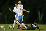 06 October 2015: North Carolina's Alan Winn (18) is fouled by UNCW's Jose Garcia (10). The University of North Carolina Tar Heels hosted the University of North Carolina Wilmington Seahawks at Fetzer Field in Chapel Hill, NC in a 2015 NCAA Division I Men's Soccer match. North Carolina won the game 3-0.