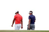 Brooks Koepka (USA) and Ian Poulter (ENG) walk off the 17th green during the third round of the 118th U.S. Open Championship at Shinnecock Hills Golf Club in Southampton, NY, USA. 16th June 2018.<br /> Picture: Golffile | Brian Spurlock<br /> <br /> <br /> All photo usage must carry mandatory copyright credit (&copy; Golffile | Brian Spurlock)
