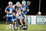 "San Francisco Dragons vs Los Angeles Riptide.Lebard Stadium, Orange Coast College,Huntington Beach, California.The Los Angeles Riptide players take the field with Anthony ""A-Train"" Kelly (#34) pushing Cameron Piorek of Aliso Niguel High School, who is paralyzed from the chest down as a result of a collision during a high school lacrosse game in April 2008.506P0752.JPG.CREDIT: Dirk Dewachter"