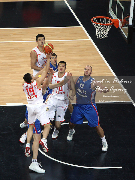 Mugedaer Xirelijiang (China) shoots for the basket. Serbia v China. The London International Basketball Invitational. London Prepares for Olympics 2012. Basketball Arena, Olympic Park. London. 17/08/2011. MANDATORY Credit Sportinpictures/Paul Chesterton - NO UNAUTHORISED USE - 07837 394578.
