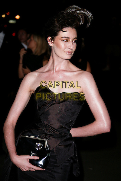 ERIN O'CONNOR.Attending The Golden Age of Couture VIP Gala held at the Victoria and Albert Museum, Kensington, London, England, September 18th 2007.V&A V & A half length black strapless clutch bag dress feather hat head piece hair.CAP/DAR.©Darwin/Capital Pictures