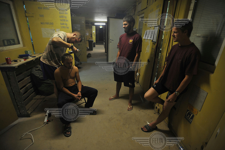 Dutch soldiers of the 11th Air Assault Battalion (Tiger Company) from ISAF (the International Security Assistance Force) cut each other's hair in their quarters at Camp Holland. ISAF is a peacekeeping mission affiliated to the United Nations (UN) and NATO. .