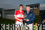 Muiris Ó Fiannachta presenting the man of the match trophy to Maitiú ÓFlaithearta (Daingean Uí Chúis) after his team defeated An Ghaeltacht during the West Kerry Senior Football Final at Gallarus GAA grounds on Saturday afternoon.