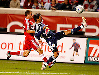 New York defender Gabriel Cichero (17) clears the ball in front of Chicago Fire midfielder Stephen King (33).  The Chicago Fire defeated the New York Red Bulls 1-0 at Toyota Park in Bridgeview, IL on September 6, 2008.