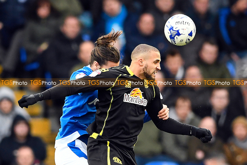 Jordan Bowery of Crewe Alexandra wins a header from Christian Burgess of Portsmouth during Portsmouth vs Crewe Alexandra, Sky Bet EFL League 2 Football at Fratton Park on 4th March 2017