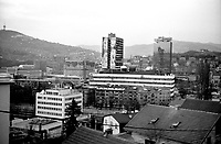 BOSNIA-HERZEGOVINA, Belgrade-Sarajevo Road, 03/2003..Lanscape pictures taken from the bus at Sarajevo. .In the center : the parliament building destroyed diring the war. On the left : the Holiday Inn where the snippers were during the war. On the left low part : the Hight Representant of the international community Headquarter. .BOSNIE-HERZEGONVINE, Route Belgrade-Sarajevo, 03/2003..Photo prise depuis le bus qui relie Belgrade à Sarajevo. Au centre : le batiment abitant le parlement détruit pendant la guerre. En bas à gauche : le quartier général du Haut Représentant de la Communauté Internationale..© Bruno Cogez / Est&Ost Photography