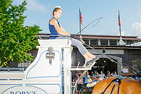 A girl drives a stagecoach into the Horse Barn for a show at the Iowa State Fair in Des, Moines, Iowa, on Sun., Aug. 11, 2019.