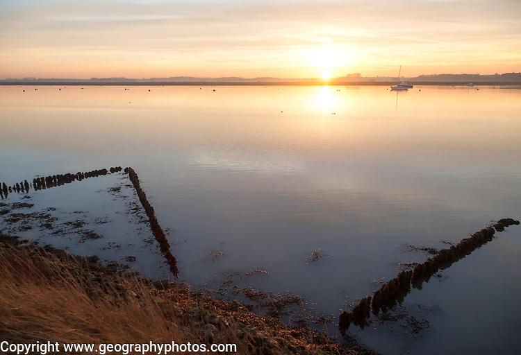 Winter landscape at sunset on the River Deben, Ramsholt, Suffolk, England