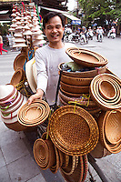 In Hanoi, life is convenient for shoppers, especially housewives. . No matter where you are, you can easily get anything you need from ubiquitous street vendors. They can make their living by carrying a yoke - baskets slung from each end of a bamboo pole, or from the back of a bicycle. Street vendors are everywhere  in Hanoi. They are up before sunrise, carrying and peddling everything from baguettes to brooms to baskets.