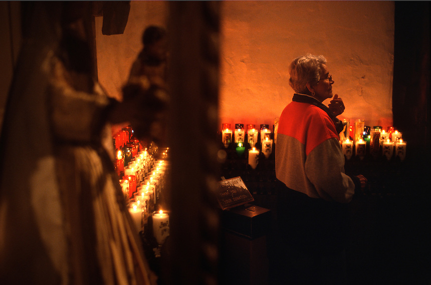 Pilgrims light votive candles inside the Santuário de Chimayó in northern New Mexico on Good Friday. Thousands of pilgrims make a pilgrimage to the 190-year-old shrine every Easter as an expression of faith, a connection to old Hispanic roots and in hopes of the miracles reputed to occur there.