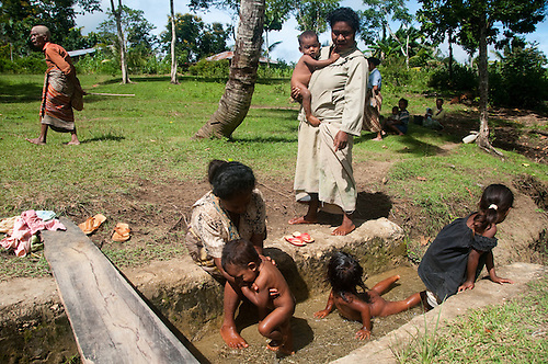 Indonesia, West Timor. Remote community had reservoirs built for them to help with all water needs. The reservoir collects the water during the rainy season and holds the water during the dry season so that they don't have to haul water.