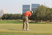 Michael Campbell (NZL) putts on the 5th green during Friday's Round 3 of the Commercial Bank Qatar Masters 2013 at Doha Golf Club, Doha, Qatar 25th January 2013 .Photo Eoin Clarke/www.golffile.ie