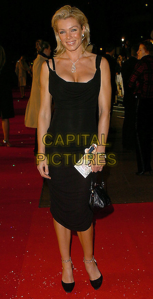 """NELL MCANDREW.""""In Her Shoes"""" UK Premiere.UK,  United Kingdom.7th November 2005.Ref: CAN.full length black dress smiling posed.www.capitalpictures.com.sales@capitalpictures.com.©Capital Pictures"""
