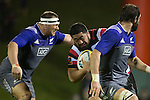 Kalolo Tuiloma looks to break between Wyatt Crockett and Sam Whitelock. The game of Three Halves, a pre-season warm-up game between the Counties Manukau Steelers, Northland and the All Blacks, played at ECOLight Stadium, Pukekohe, on Friday August 12th 2016. Photo by Richard Spranger.