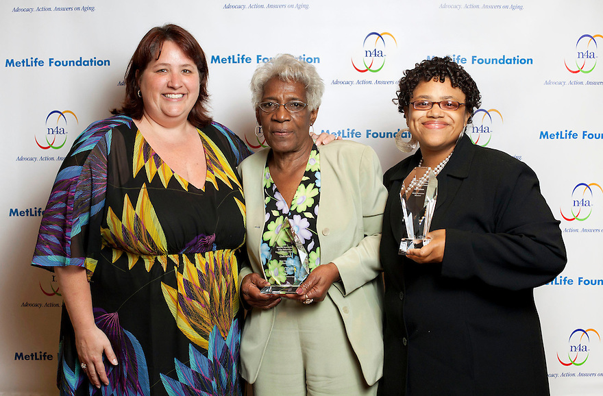 Silver honoree Clarie Miller with Julie Bonamarte, left, and Alisha Knight, right, at the Older Volunteers Enrich America Awards at the Double Tree Hotel in Washington, DC on Friday, June 17, 2011.