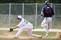 25 April 2010: Bertrand Dubaut of the PUC catches the ball at first base during game 1/week 3 of the French Elite season won 12-4 by Rouen over the PUC, at the Pershing Stadium in Vincennes, near Paris, France.