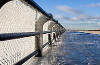 Chain link fence encased in ice.