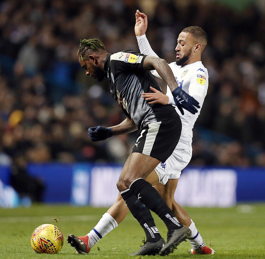 Reading's Leandro Bacuna shields the ball from Leeds United's Kemar Roofe and Jack Clarke<br /> <br /> Photographer Rich Linley/CameraSport<br /> <br /> The EFL Sky Bet Championship - Leeds United v Reading - Tuesday 27th November 2018 - Elland Road - Leeds<br /> <br /> World Copyright © 2018 CameraSport. All rights reserved. 43 Linden Ave. Countesthorpe. Leicester. England. LE8 5PG - Tel: +44 (0) 116 277 4147 - admin@camerasport.com - www.camerasport.com