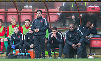 former Leyton Orients U16s Manager Frederico Morias (left) looks on with the bench looking concerned after the first team manager is sent off at HT during the Sky Bet League 2 match between Leyton Orient and Wycombe Wanderers at the Matchroom Stadium, London, England on 1 April 2017. Photo by Andy Rowland.