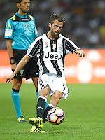 Calcio, Serie A: Inter vs Juventus. Milano, stadio San Siro, 18 settembre 2016.<br /> Juventus&rsquo; Miralem Pjanic kicks the ball during the Italian Serie A football match between FC Inter and Juventus at Milan's San Siro stadium, 18 September 2016.<br /> UPDATE IMAGES PRESS/Isabella Bonotto
