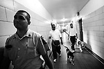 BEACON, NEW YORK:  Tyrone (C) and Andy (R) escort their puppies, Happy and Rezzie, back to their residence after visiting sick prisoners in the medical ward at Fishkill Correctional Facility as part of the Puppies Behind Bars Program. The patients look forward to the visits which are also used as a training exercise for the puppies.