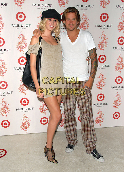 KIMBERLY STEWART & SEAN STEWART.Sophie Albou's Paul & Joe Collection for The Opening of Target Temporary Boutique on Melrose in Beverly Hills, California, USA..July 27th, 2006.Ref: DVS.full length grey gray dress black bag purse hat white tee shirt tattoos sister brother siblings family ankle boots brown checkered trousers.www.capitalpictures.com.sales@capitalpictures.com.©Debbie VanStory/Capital Pictures