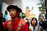 Carrying a great flag, the young man was the head of this traditional procession in Sapporo, Japan