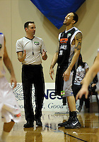 Umpire Dallas Pickering explains a foul to Hawks import Jon Rogers in the final minute of the match. NBL Semifinal - Wellington Saints v Bay Hawks at TSB Bank Arena, Wellington on Friday, 25 June 2010. Photo: Dave Lintott/lintottphoto.co.nz