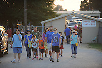 NWA Democrat-Gazette/ANDY SHUPE<br /> Fairgoers exit Thursday, Sept. 3, 2015, during the Washington County Fair at the county fairgrounds in Fayetteville.