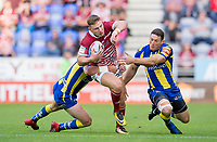 Picture by Allan McKenzie/SWpix.com - 13/07/2017 - Rugby League - Betfred Super League - Wigan Warriors v Warrington Wolves - DW Stadium, Wigan, England - WIgan's George Williams is tackled by Warrington's Ben Pomeroy.