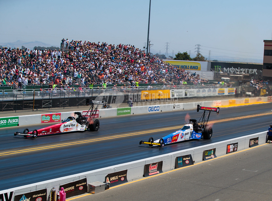 Jul 28, 2019; Sonoma, CA, USA; NHRA top fuel driver Clay Millican (left) alongside Brittany Force during the Sonoma Nationals at Sonoma Raceway. Mandatory Credit: Mark J. Rebilas-USA TODAY Sports