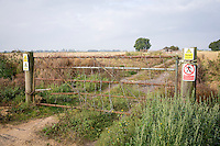 Farm gate with signs, chain and lock