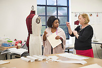 Fleshia Gillon, a junior fashion design and merchandising major from Louisville, listens to the advice of Visiting Professor Catherine Black during her draping class in the Moore Hall studio on Tuesday [Nov. 1].<br />