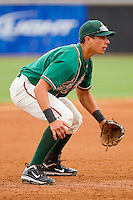 Third baseman Ryan Fisher #21 of the Greensboro Grasshoppers on defense against the Hickory Crawdads at L.P. Frans Stadium on May 18, 2011 in Hickory, North Carolina.   Photo by Brian Westerholt / Four Seam Images