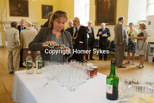 Jankyn Smyth Cake and Ale ceremony at the Guildhall Bury St Edmunds Suffolk 2015. Greene King a local brewery provides bottles of IPA.