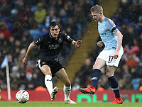 Manchester City's Kevin De Bruyne passes under pressure from Burnley's Jack Cork<br /> <br /> Photographer Rich Linley/CameraSport<br /> <br /> Emirates FA Cup Fourth Round - Manchester City v Burnley - Saturday 26th January 2019 - The Etihad - Manchester<br />  <br /> World Copyright © 2019 CameraSport. All rights reserved. 43 Linden Ave. Countesthorpe. Leicester. England. LE8 5PG - Tel: +44 (0) 116 277 4147 - admin@camerasport.com - www.camerasport.com