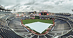 7 April 2016: A white tarp covers the infield on a rainy morning prior to the Washington Nationals Home Opening Game against the Miami Marlins at Nationals Park in Washington, DC. The Marlins defeated the Nationals 6-4 in their first meeting of the 2016 MLB season. Mandatory Credit: Ed Wolfstein Photo