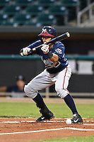 Mississippi Braves shortstop Gustavo Nunez (4) attempts a bunt during a game against the Montgomery Biscuits on April 21, 2014 at Riverwalk Stadium in Montgomery, Alabama.  Montgomery defeated Mississippi 6-2.  (Mike Janes/Four Seam Images)