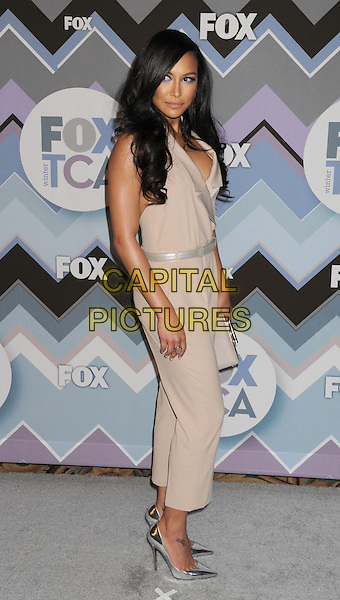 Naya Rivera.arriving at the 2013 TCA Winter Press Tour - FOX All-Star Party at The Langham Huntington Hotel and Spa in Pasadena, California, USA, .January 8th, 2013.   .full length beige catsuit pantsuit side  silver shoes belt mirrored shiny .CAP/ROT/TM.©Tony Michaels/Roth Stock/Capital Pictures